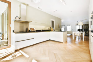 Spacious kitchen with white cabinets